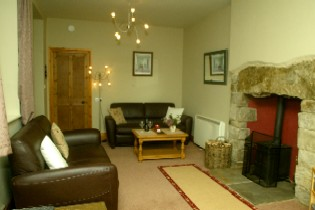 The warm, cosy lounge at Stationhouse self-catering